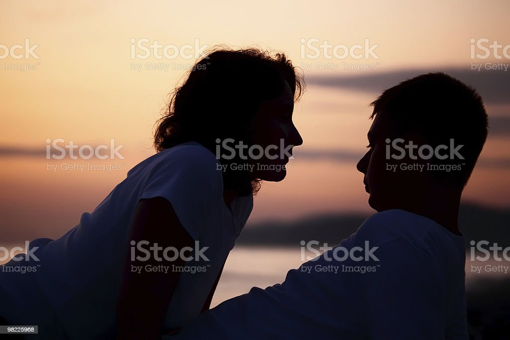 Silhouette man and woman on beach royalty-free stock photo