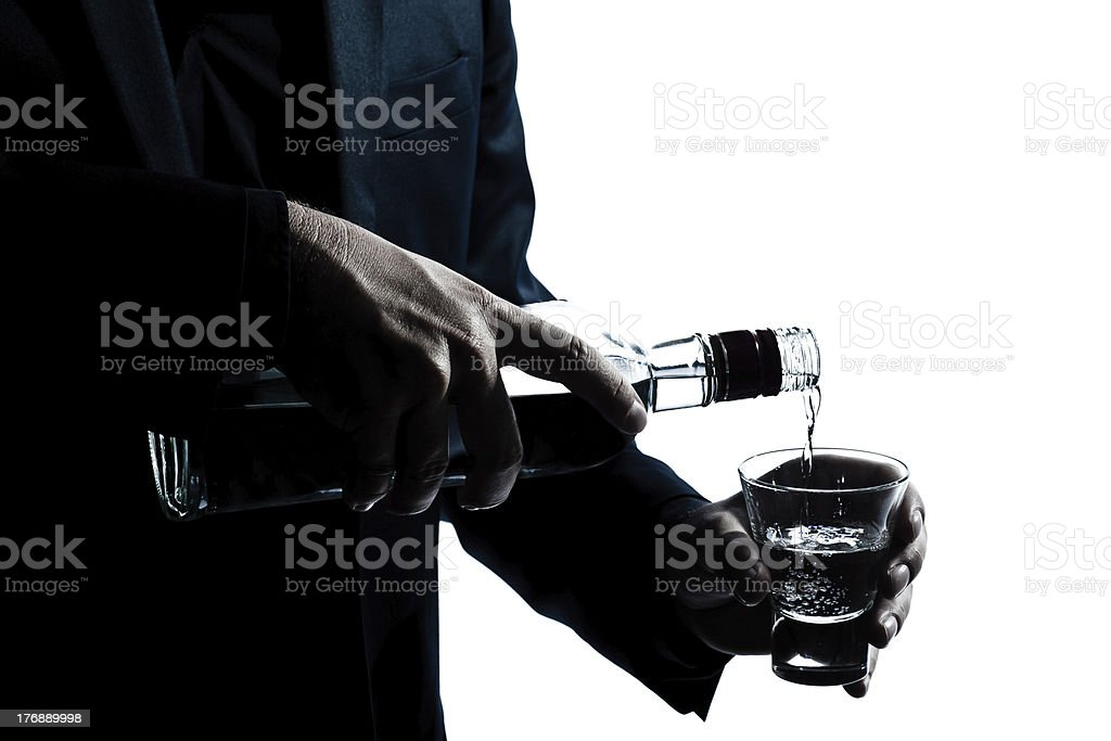 silhouette man hands close up pouring white alcohol stock photo