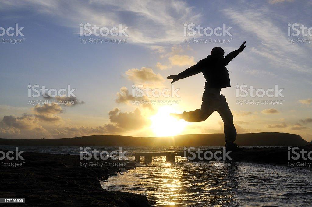 Silhouette Man Jumping. stock photo