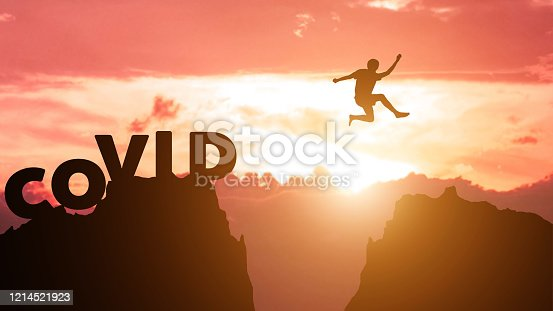 Silhouette man jumps to survive from corona virus , COVID-19. The concept of humankind that must overcome this epidemic crisis. Fight and escape from Covid