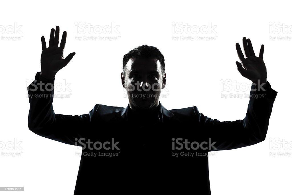 silhouette man portrait hands up stock photo