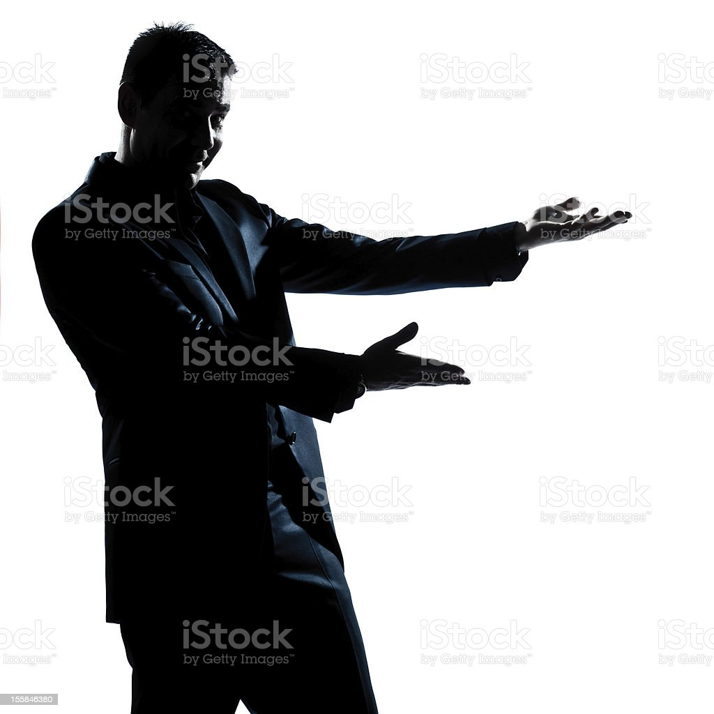 silhouette man portrait showing pointing empty copy space royalty-free stock photo