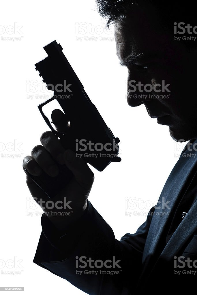 silhouette man portrait with gun royalty-free stock photo
