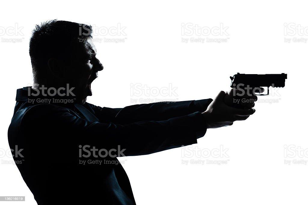 silhouette man portrait with gun royalty-free stock photo