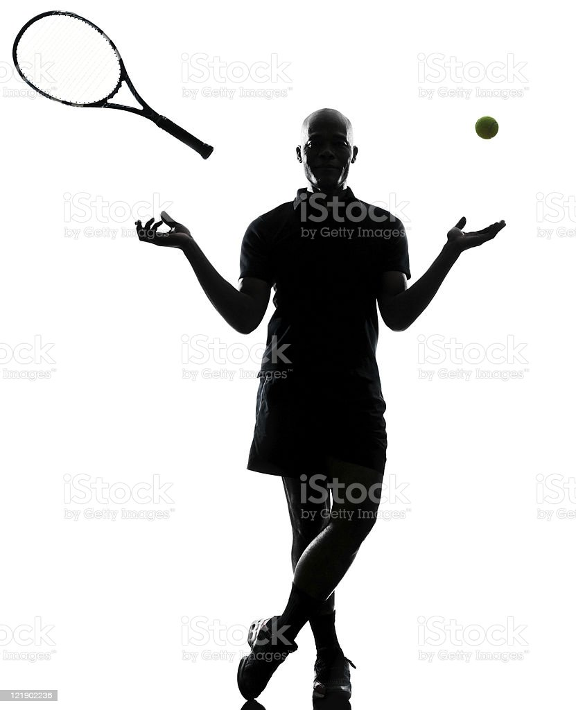 silhouette  man tennis player standing throwing ball and racket royalty-free stock photo