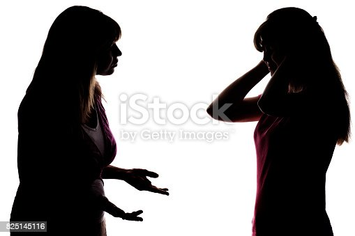istock Silhouette mom trying talking but teenager does not want to listen 825145116