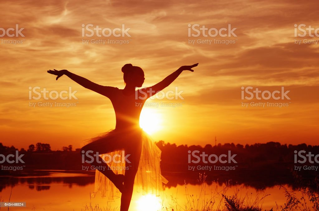 Silhouette of a Ballet Dancer at Sunset Outdoors stock photo