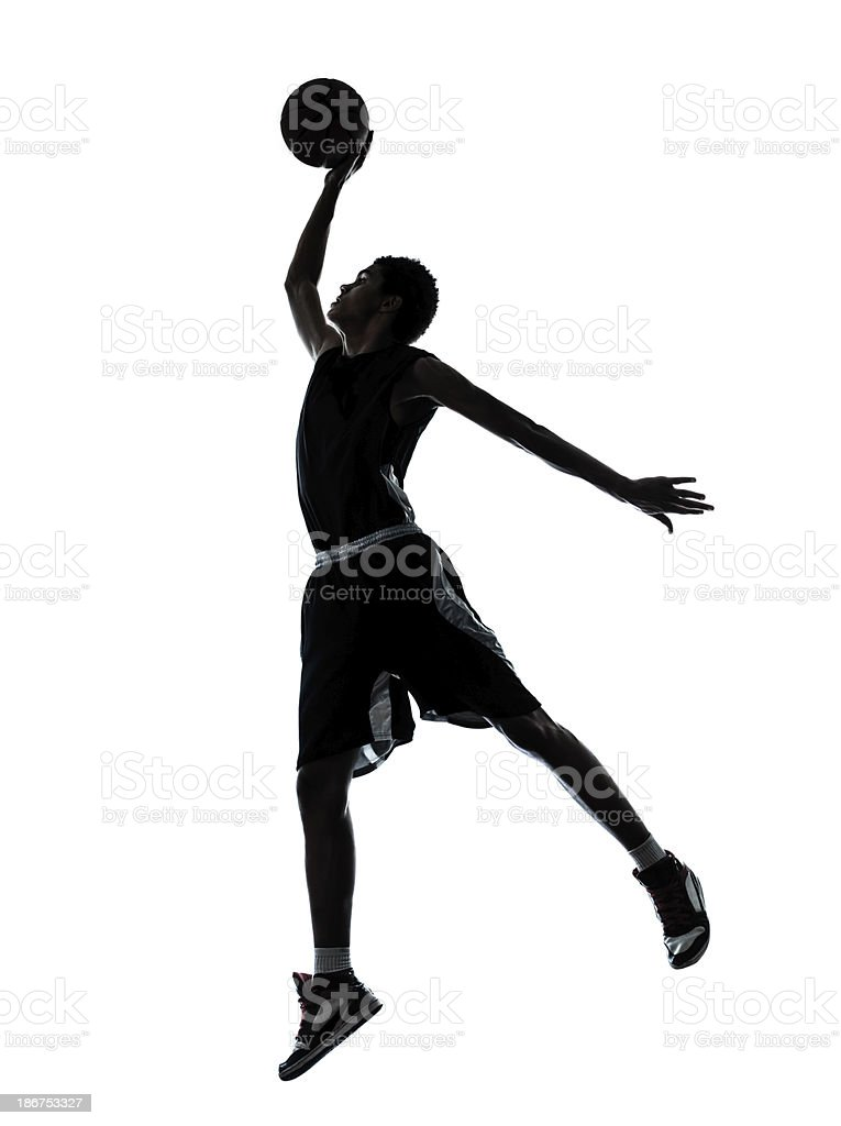 Silhouette of a basketball player dunking stock photo