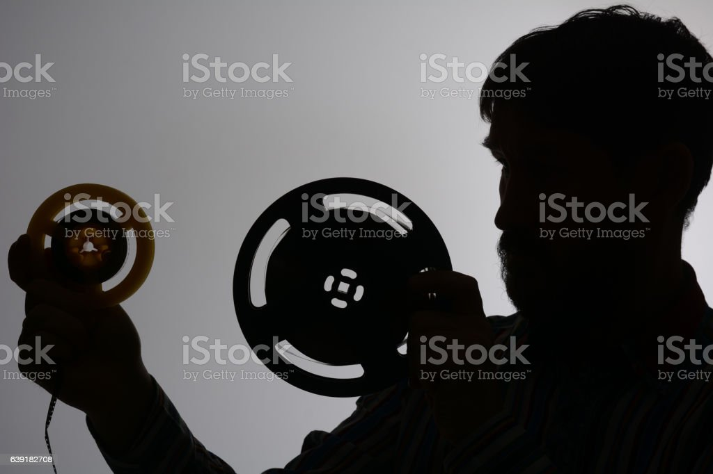 Silhouette of a bearded man looking stock photo
