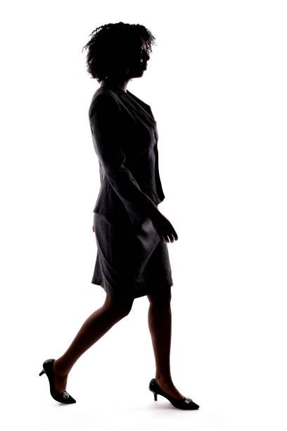 Silhouette of a Black Businesswoman Walking stock photo