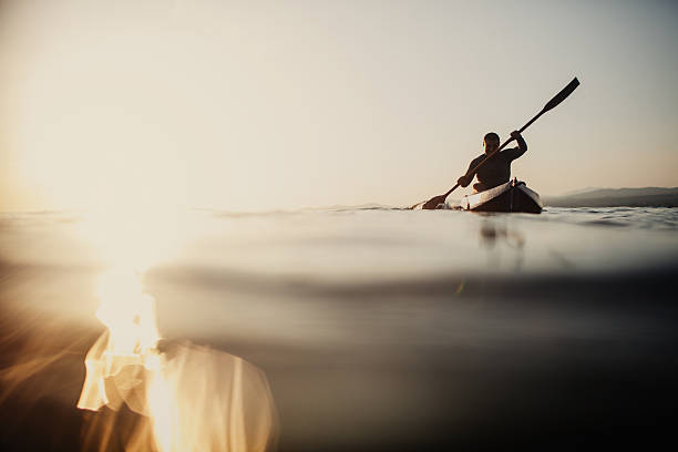 Silhouette of a canoeist - Photo
