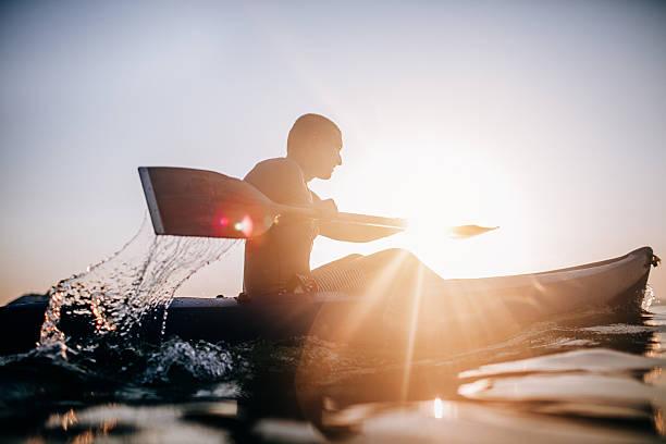 Silhouette of a canoeist - foto de stock