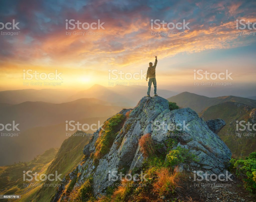 Silhouette of a champion on mountain peak stock photo