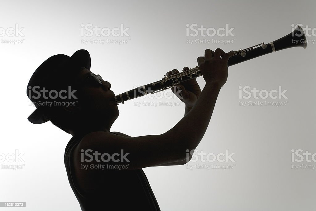Silhouette of a clarinetist stock photo