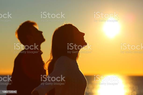 Silhouette of a couple of friends breathing at sunset picture id1063703340?b=1&k=6&m=1063703340&s=612x612&h=09zb0e7qiojyhgbr689fmgaoyovxet15usejpqbf78s=