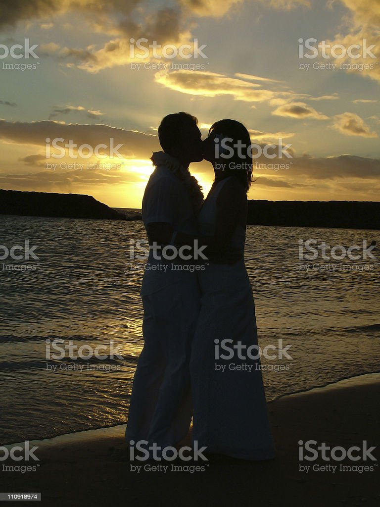 Silhouette of a couple on the beach, wedding ceremony royalty-free stock photo