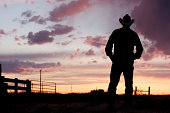 istock Silhouette of a cowboy at day break 157198928