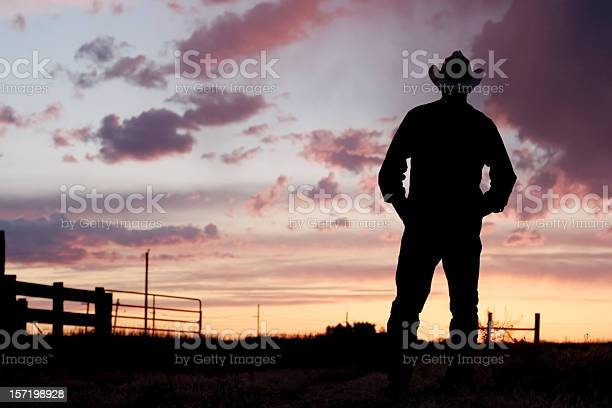 Photo of Silhouette of a cowboy at day break