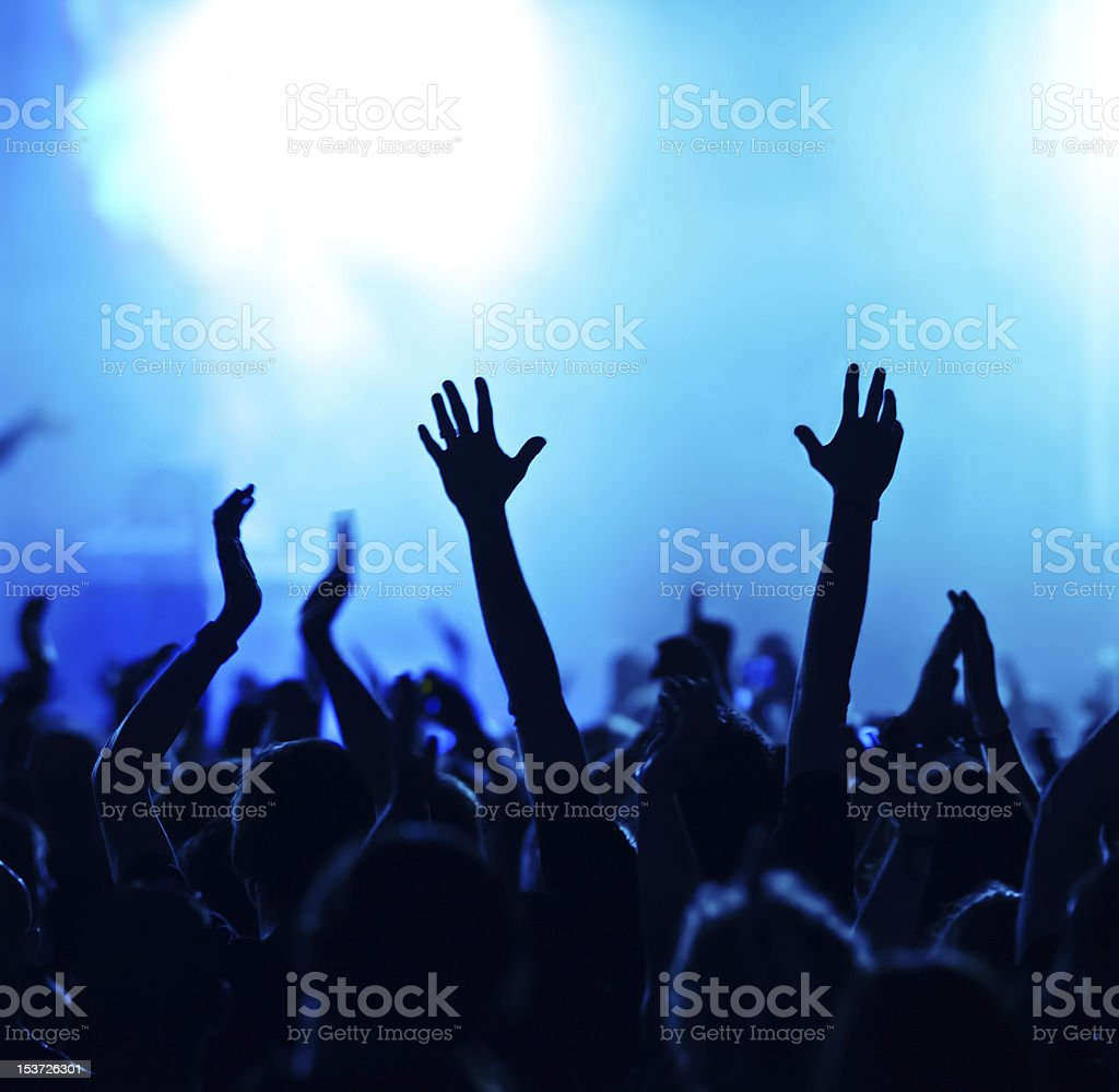 A silhouette of a crowd at a large concert  royalty-free stock photo