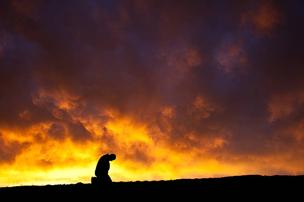 a silhouette of a depressed man - man face down stock pictures, royalty-free photos & images
