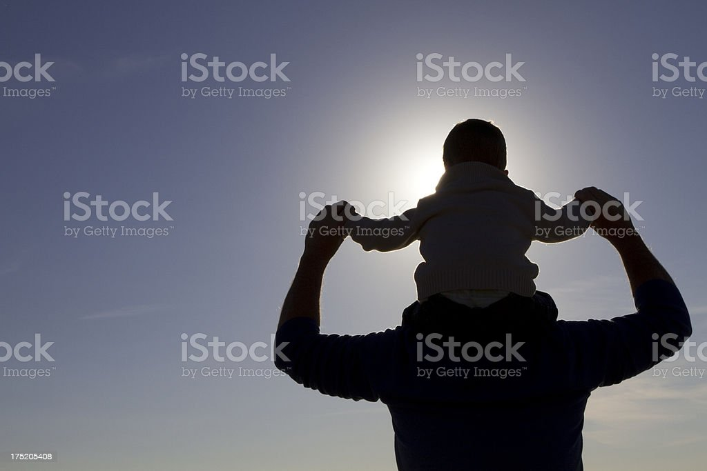 Silhouette of a father and son playing outdoors royalty-free stock photo