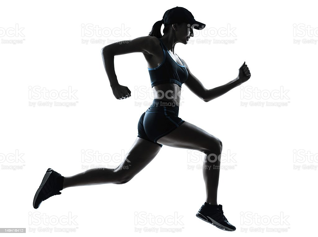 Silhouette of a female athlete jogging royalty-free stock photo