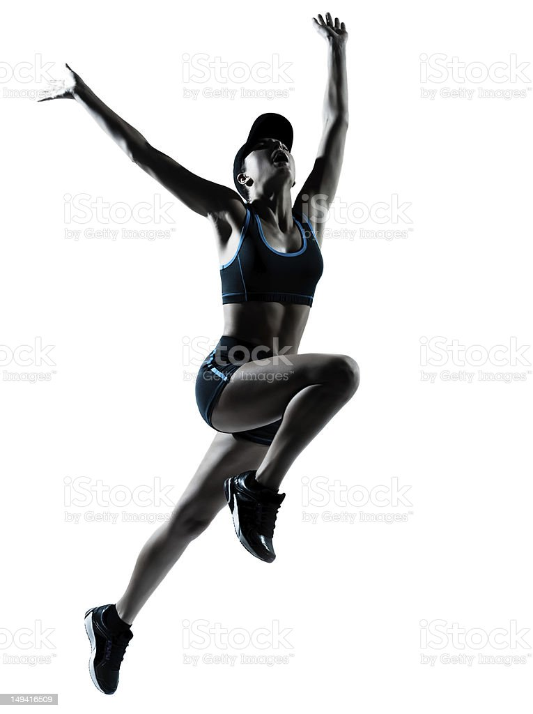 Silhouette of a female athlete jumping royalty-free stock photo