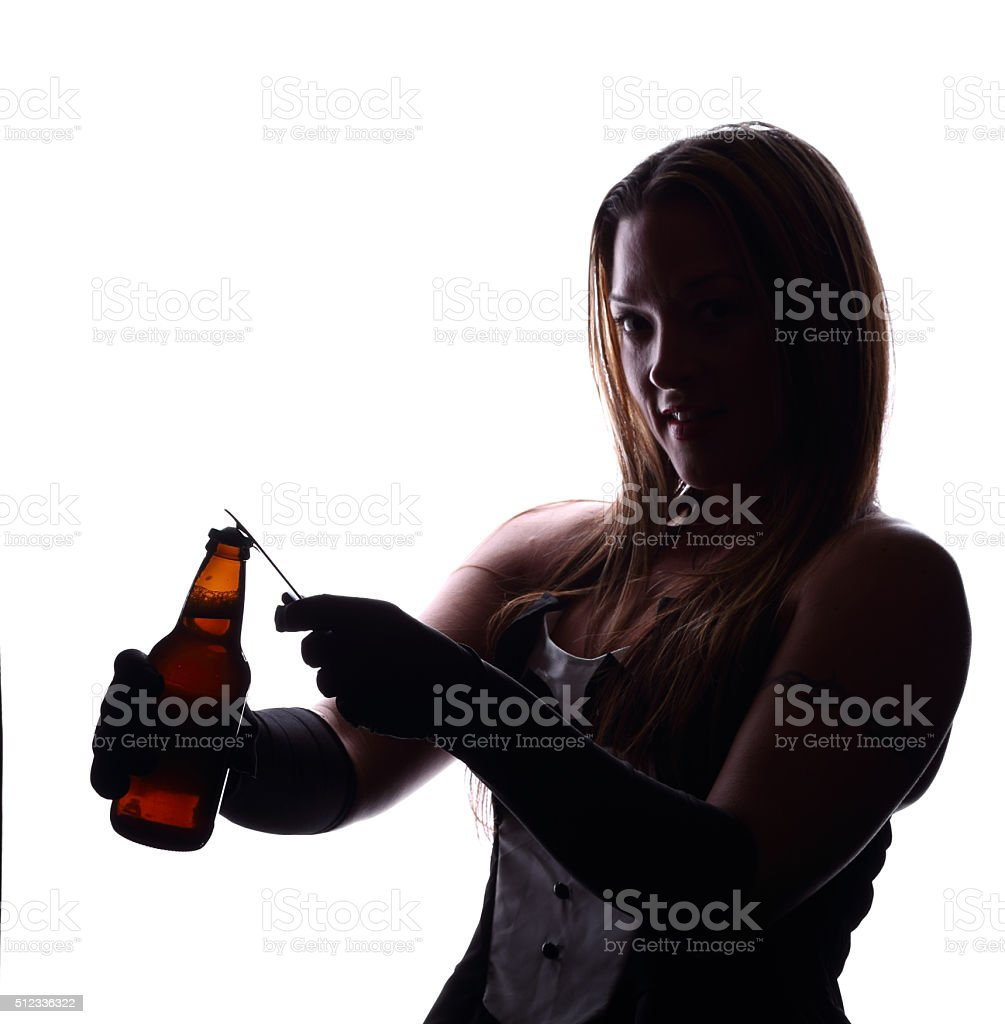 Silhouette of a female bartender opening a bottle of beer stock photo