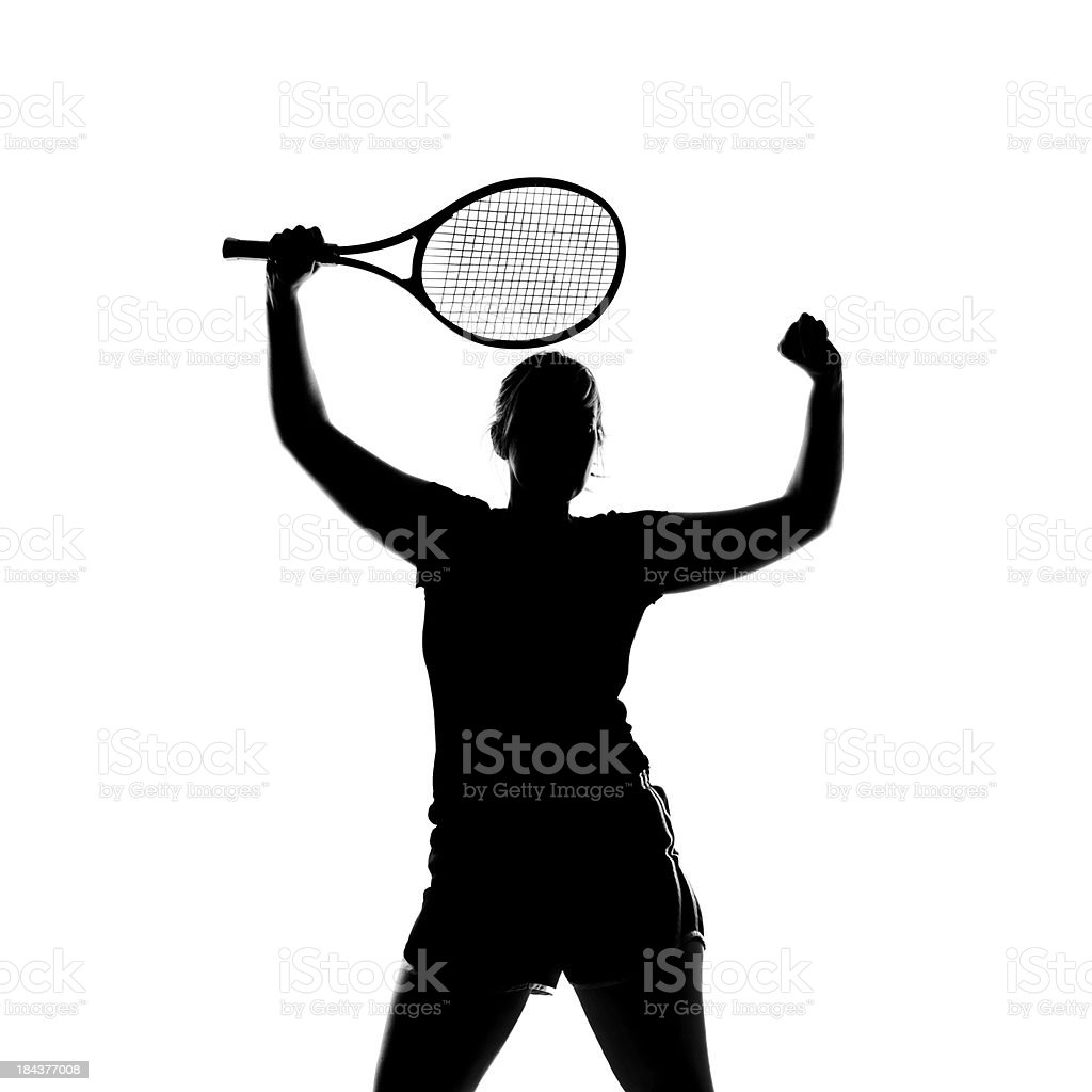 A silhouette of a female celebrating her tennis victory. royalty-free stock photo