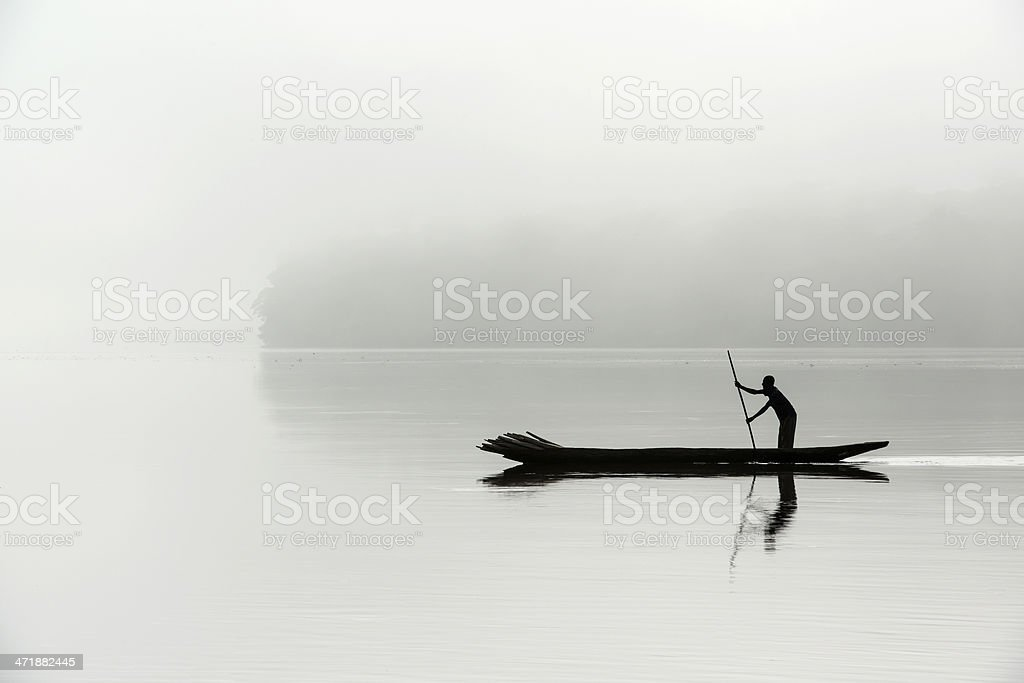 Silhouette of a fisherman in the morning fog, Congo river stock photo