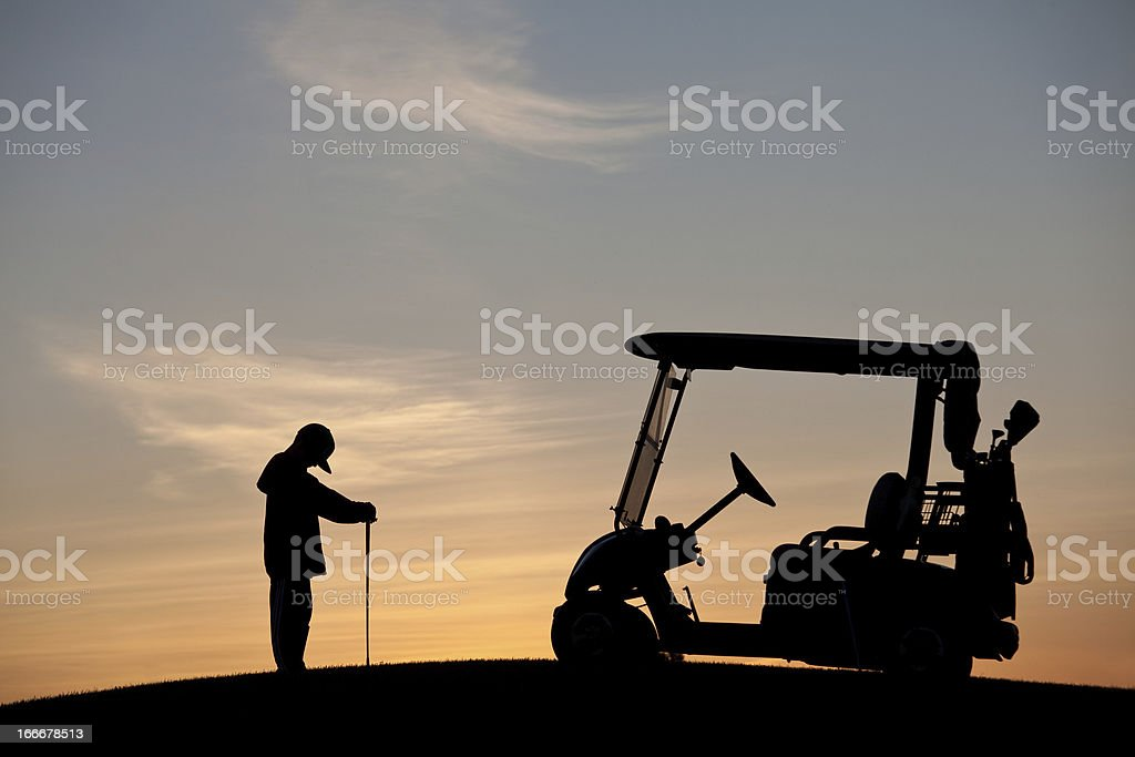 Silhouette of a Frustrated and Depressed Child Golfing royalty-free stock photo