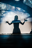 silhouette of a girl acting on stage