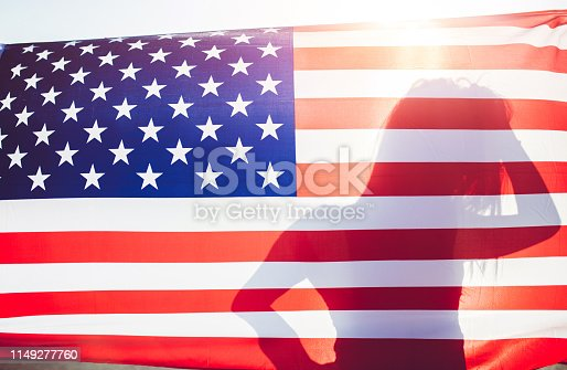 Silhouette of a girl behind the USA flag