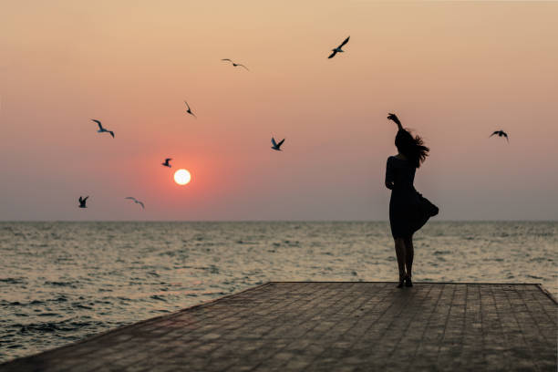 Royalty Free Beautiful Girl Standing Alone In The Sea Pictures, Images And Stock Photos - Istock-2934