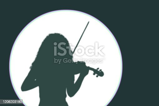 istock Silhouette of a girl violinist on a white circle from lighting with copy space. 1206203180