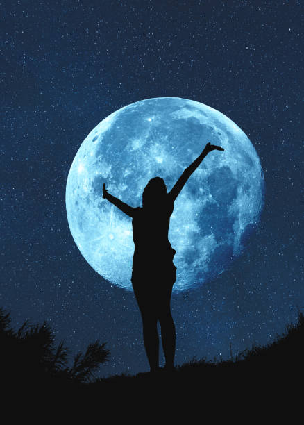 silhouette of a girl with hands in the air at moonlit night. my astronomy work. - romantic moon stock photos and pictures