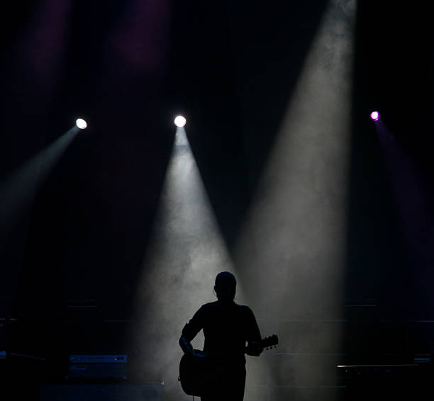 Silhouette Of A Guitar Player stock photo
