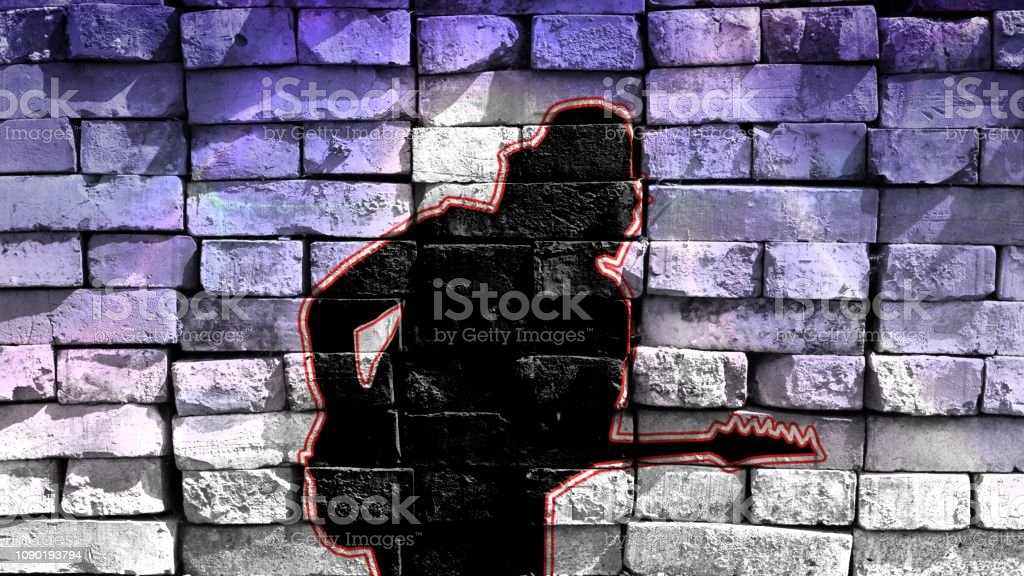 Silhouette of a guitarist in a baseball cap playing the guitar on a colorful background. Virtual graffiti. Image, drawn on a photo of a brick wall. stock photo