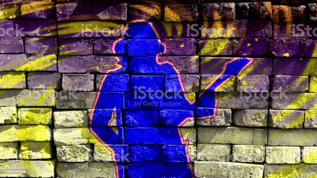 Silhouette of a guitarist in a baseball cap playing the guitar on a bright background. Virtual graffiti. Image, drawn on a photo of a brick wall. stock photo