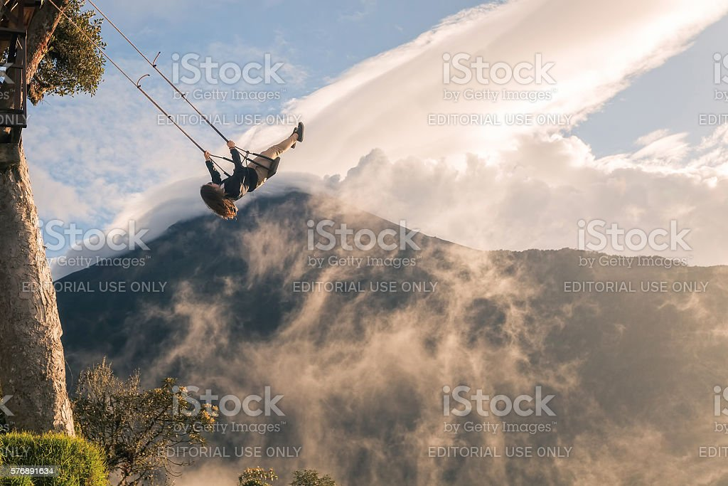 Silhouette Of A Happy Young Teenager Girl Swinging stock photo