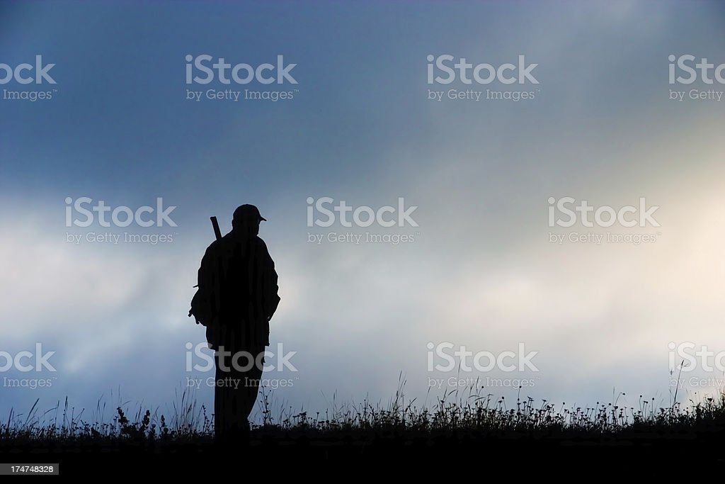 Silhouette of a hunter royalty-free stock photo