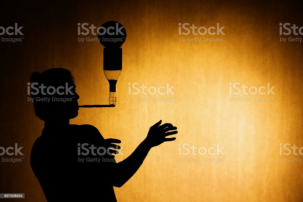 silhouette of a juggler stock photo