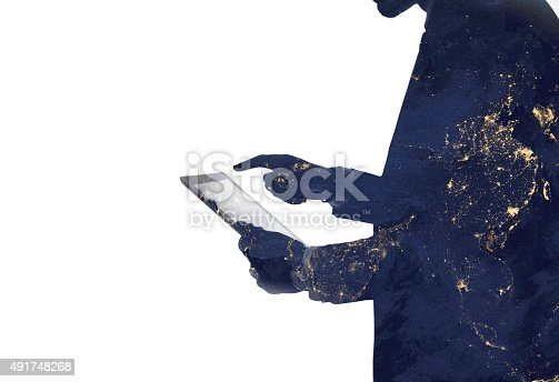 istock Silhouette of a man and digital tablet with galaxy overlaid 491748268