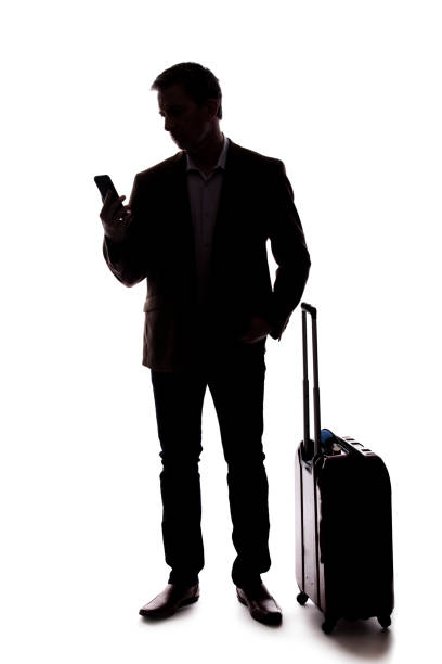 Silhouette of a Man Calling for a Rideshare stock photo