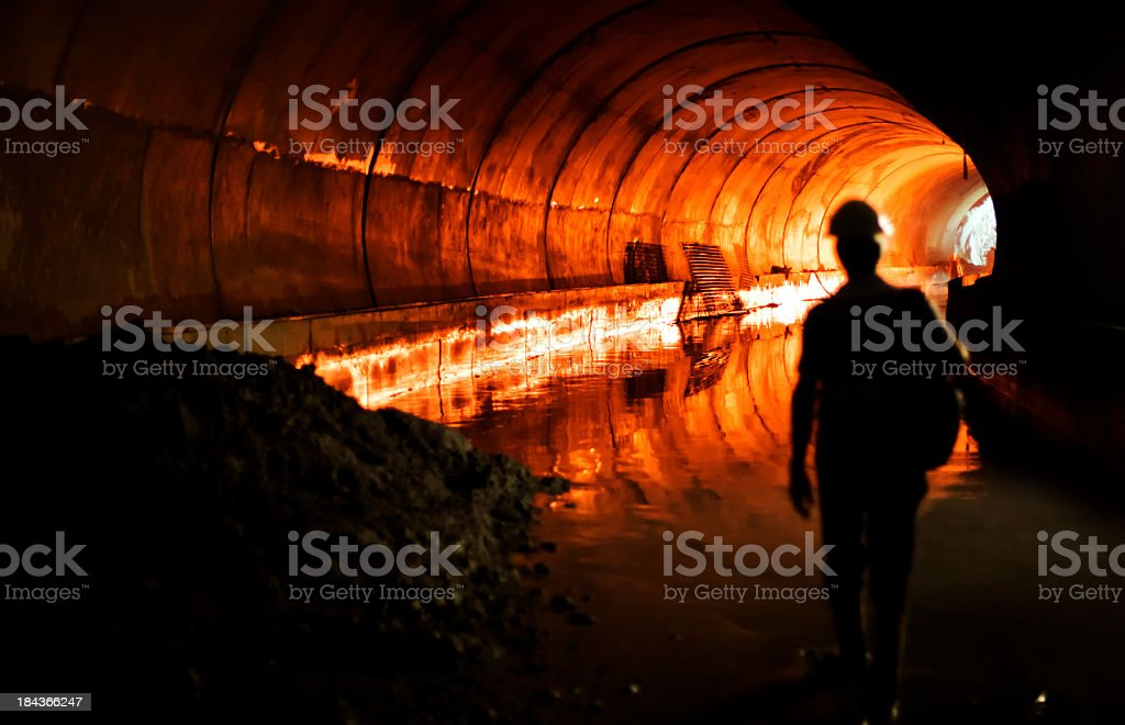 A silhouette of a man in a subway stock photo