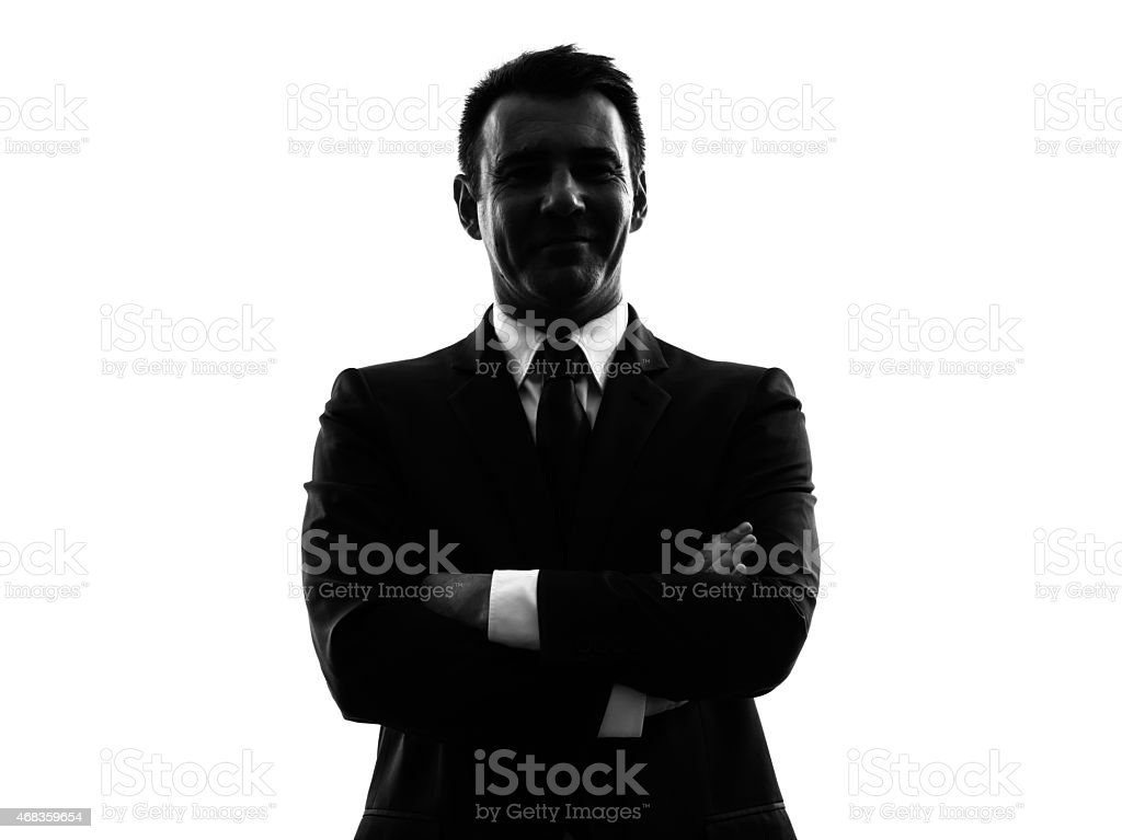 Silhouette of a man in a suit on a white background royalty-free stock photo