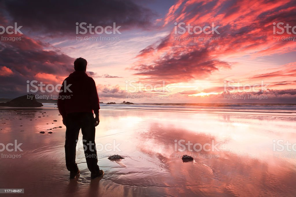 A silhouette of a man on a beach royalty-free stock photo