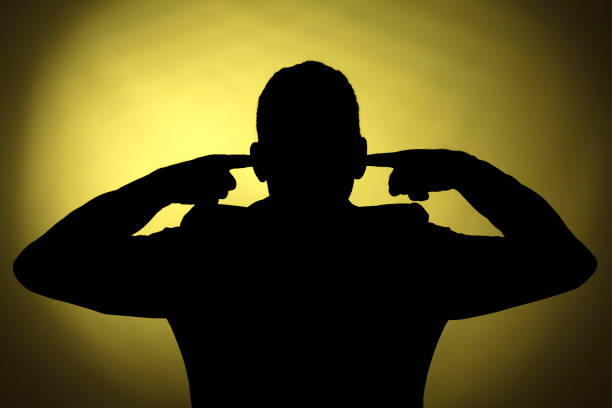 Silhouette of a man Profile of a  man closing his ears hands covering ears stock pictures, royalty-free photos & images