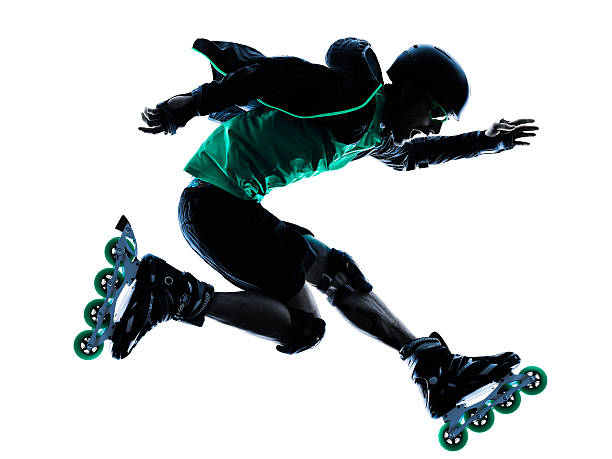 A silhouette of a man roller skating stock photo