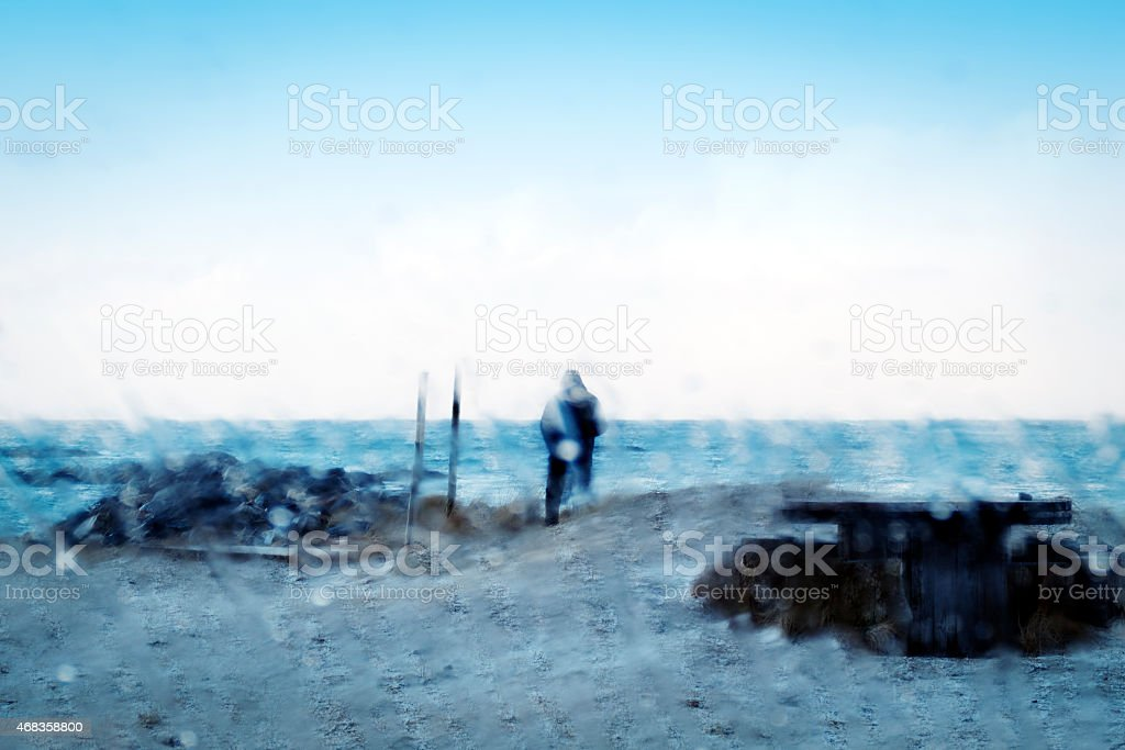 Silhouette of a man, seen from behind a humid window royalty-free stock photo